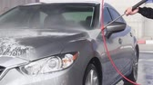 xampu : Slow Motion Video of a Car Washing Process on a Self-Service Car Wash