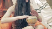 djembe : Young girl playing on traditional Indian tabla drums close up Stock Footage