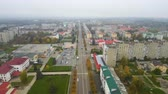 dálnice : Aerial view from Drone: Small town with a road and cars, houses and parking lots. Dostupné videozáznamy
