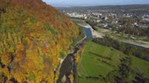 collage : Aerial, top view from Drone: flying over the mountain with forest and river. Forest yellow autumn color. River at the foot of the mountain.