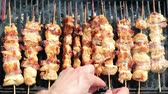 chargrilled : Juicy roasted chicken skewers,made of white meat and bacon, being turned on the bbq.HD 1080p.GoProHERO3.