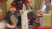 wróżka : Excited siblings on Christmas morning. They both run up to their mother for a cuddle, before receiving presents from both their parents. Wideo