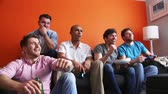 gamers : Group of men are having fun at home, playing video games. Stock Footage