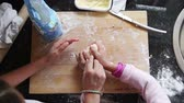 nabiał : View from above of sisters kneading dough together at home to make biscuits. Wideo