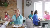 listening : Women are in a cafe, socialising over tea and coffee. Stock Footage