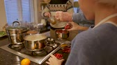 produktivita : Little boy is helping his father and grandfather make a Christmas dinner. Dostupné videozáznamy