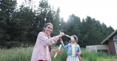 домик : Slow motion shot of sisters, moving and playing with bubble wands, creating bubbles. Стоковые видеозаписи