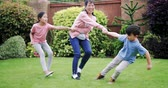 puro : Two children are playing in the garden in summer with their mother.