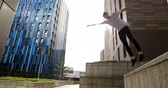 conquering : Freerunner is doing a flip from a wall in Newcastle city centre.