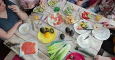 бублик : High angle view of a table set with a variety of healthy food. There are unrecognisable people sitting around the table. Стоковые видеозаписи