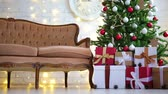 decorated living room with christmas tree, gifts and lights Стоковые видеозаписи