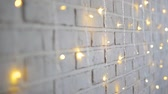 christmas background - brick wall with lights and sparkle Стоковые видеозаписи