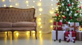 christmas background - decorated living room with christmas tree, gift boxes and lights