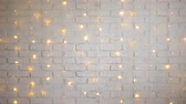 christmas background - white brick wall with shiny lights