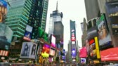 financial : Times Square in New York City time lapse with blurred trademarks