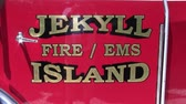 bombeiro : Jekyll Island, Georgia, USA - Circa July 2013: Jekyll Island Fire Department and EMS Logo on the Red Door of a Fire Engine in Glynn County, Georgia. Stock Footage