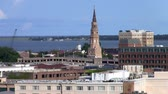 spirál : Cityscape of Charleston, South Carolina with the Spire of St. Phillips Episcopal Church, Aerial View with the Sea in the Background Stock mozgókép