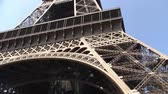 известный : Eiffel Tower in Paris France, Steel Structure, Vertical Pan on a sunny day. Built by Gustave Eiffel in 1889. Стоковые видеозаписи