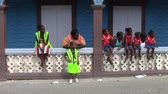 martin : Marigot, Saint Martin - July 14 2013: Group of African-Caribbean Spectators at the Parade on July 14, the National Holiday of France in Marigot, on the Tropical Island of Saint Martin, also called Sint Maarten.