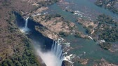 zambia : Spectacular Aerial View of Victoria Falls between Zimbabwe and Zambia, Africa from Helicopter in 4k