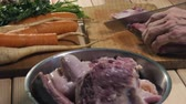 caldo : Preparing ingredients for beef broth. Cutting meat. Stock Footage