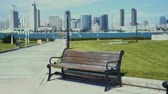 coronado : 4K San Diego skyline view from Coronado Centennial park with park bench on the foreground.