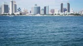 coronado : 4K San Diego skyline camera slow tilt up from water to downtown buildings.