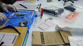 evidência : Police scientist working in Criminalistic Laboratory, bullet shell analysis, conceptual image