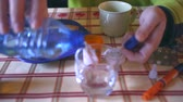 доза : Medication during breakfast, capsules next to a glass of water