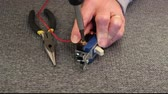 fornecimento : attaching a power wire to an electric switch Stock Footage