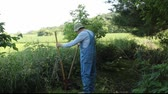 carreira : farmer digging a hole for a new fence post