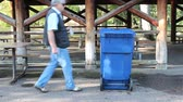 man places a plastic bottle into a recycle bin Stock Footage