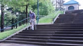 injured man using a walker to descend a set of steps
