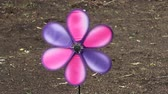 a colorful pinwheel spinning in the wind