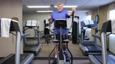 mature man exercising on an eliptical machine