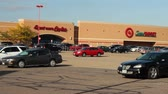 Shopper entering and leaving a Target Superstore Stock Footage