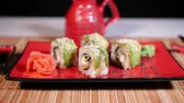 chopstic : Japanese Green Sushi On Plate With Chopsticks On Bamboo Background