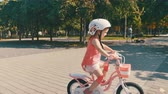 kask : Happy Child in Safety Helmet Riding a Bike in Outdoor