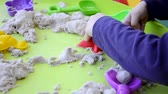 plíseň : Creative boy making figures from kinetic sand at lesson