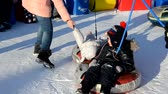 Winter fun, snow, happy children sledding at winter time. Mother, sun and toddler dother Wideo
