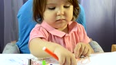 Little girl painting at table, creativity development, draw a picture, early start, preschool concept