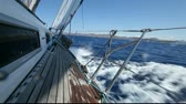 waves : Sailing in the wind through the waves (HD) Sailing boat shot in full HD at the Mediteranean sea. Stock Footage