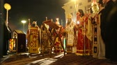 sábado : ATHENS, GREECE - APR 12, 2015: Unknown people during celebration of Orthodox Easter (Midnight Office of Pascha) Holy Saturday is often the only time that the Midnight Office will be read in parishes. Vídeos