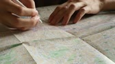 borracha : Hand makes notes in pencil on the map HD