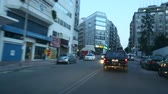asphalt : ATHENS, GREECE - CIRCA APR, 2015: Driving on the streets at Athens, twilight, the road to the Port, view through the front windshield.