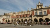 first : KRAKOW, POLAND - MAY 3, 2015: Military orchestra on main square of Krakow during annual Polish national and public holiday Constitution Day May 3, 1791 was adopted first Constitution of modern Europe. Stock Footage