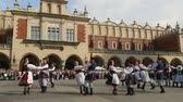 trough : KRAKOW, POLAND - MAY 3, 2015: Polish folk collective on Main square during annual Polish national and public holiday the Constitution Day - May 3, 1791 was adopted first Constitution of modern Europe.
