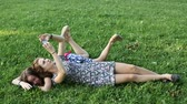 best : Cute teen girls girlfriends lying on the lawn taking pictures of himself on a mobile phone, selfie.