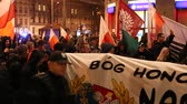 politics : KRAKOW, POLAND - NOV 11, 2015: Nationalists protest in center of Krakow. About 3.000 people took part in March of Free Poland. Participants chanted slogans Neither EU nor NATO, Poland only for Poles. Stock Footage