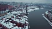 Drone flies over the Moscow River to the monument of Peter the Great. All roofs of buildings in the snow. Winter. Overcast weather. Stock mozgókép